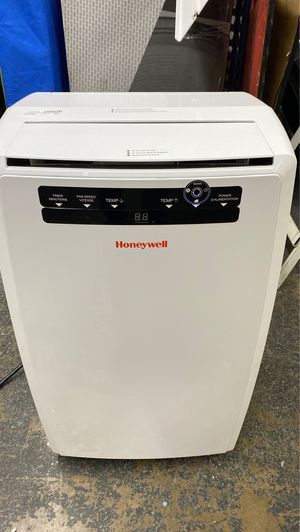 Honeywell portable ac unit great condition with hoses and remote for Sale in Dallas, TX