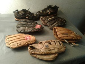 Baseball gloves and a pair of baseball cleats for Sale in Las Vegas, NV