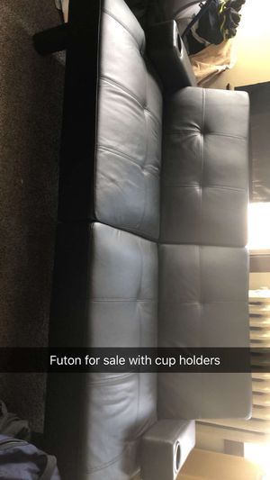 Black leather futon with cup holders for Sale in Oskaloosa, IA