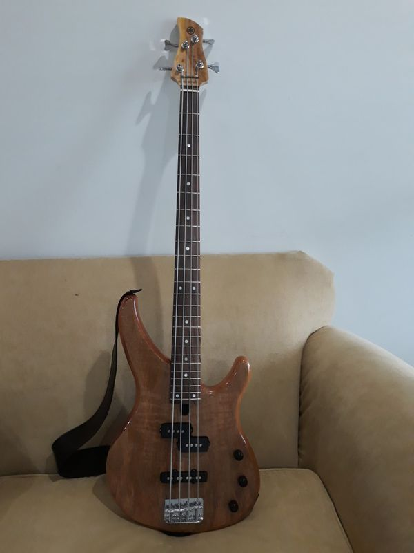 Bass Guitar, Combo, strap cord and guitar bag.