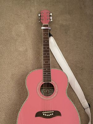 New / Never used Oscar Schmidt pink guitar with capo and strap for Sale in Littleton, CO