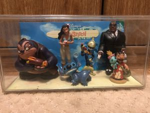 Disney lilo and stitch collectible figures with display case for Sale in Los Angeles, CA