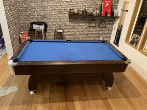 Pool Table. Balls, cues, racks included for Sale in Ruston, WA