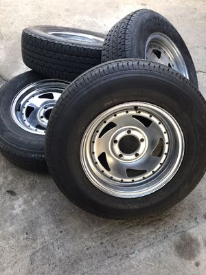 """Used trailer wheels and tires 14"""" 5x4.5 for Sale in Modesto, CA"""
