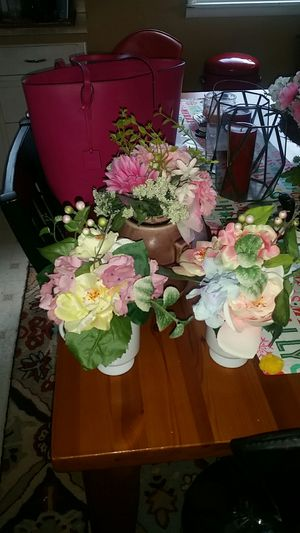 Three bouquets of fake flowers in containers for Sale in Tacoma, WA