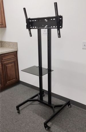"New in box 28"" depth x 26"" wide x 65"" tall 32 to 65 inch tv television heavy duty stand with locking wheels and shelf soporte de tv for Sale in Whittier, CA"