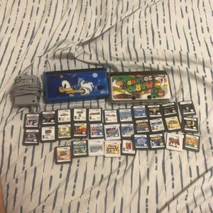 Nintendo 3ds + Nintendo DS with 30 Games And Protective Cases Included for Sale in Hialeah, FL