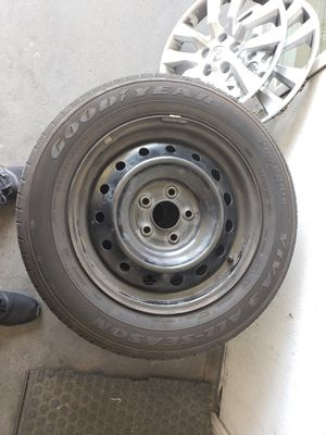Nissan Altima hubcaps and tires 215/60/R16 for Sale in Riverside, CA