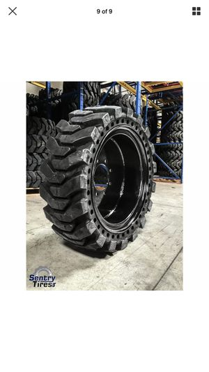A Set of 4 Skid Steer Tires with Rims Size 12-16.5 8 bolt holes for Sale in Loma Linda, CA