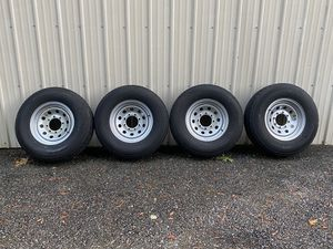 Set of (4) ST235 / 80R16 Tires w/ 8 Lug Steel Wheels for Sale in Snohomish, WA