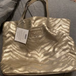 Brand New Gold Michael Kors Purse for Sale in Corvallis, MT
