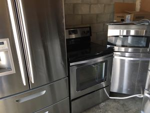 Nice stainless steel package fridge stove dishwasher microwave working fine for Sale in Orlando, FL