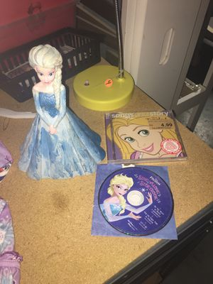 DISNEY FROZEN ❄️ Elsa piggy bank and two cds 💿❄️ one is song and story and the other is a song a long story book!!! ❄️❄️❄️❄️ for Sale in Las Vegas, NV
