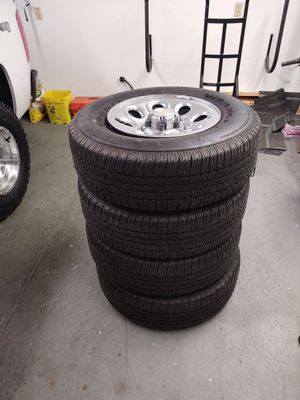 Goodyear Wrangler tires with Chevy Silverado stock wheels for Sale in Vancouver, WA
