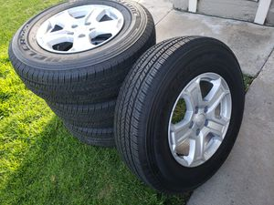 jeep wheels and tires bridgueston dueler for Sale in Jamul, CA