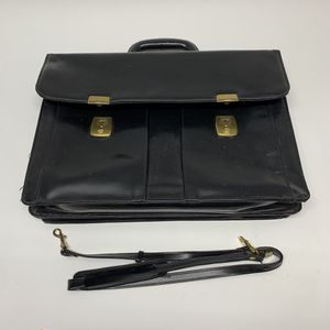 Small leather brief case with straps for Sale in Topeka, KS