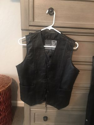 Motorcycle leather vest and chairs and helmet for Sale in Visalia, CA
