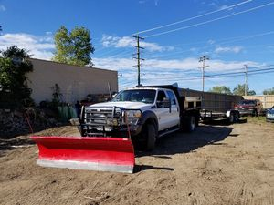 2012 Ford F-450 super cab with a 12ft bed NOW WITH PLOW Landscapers dream truck for Sale in Ingleside, IL