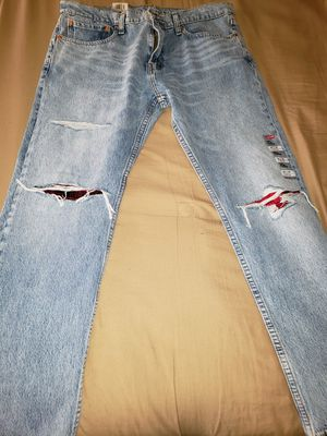 FIRM PRICE - Levi Slim Tapered 36x30 Blue distressed jeans. for Sale in Cleveland, OH