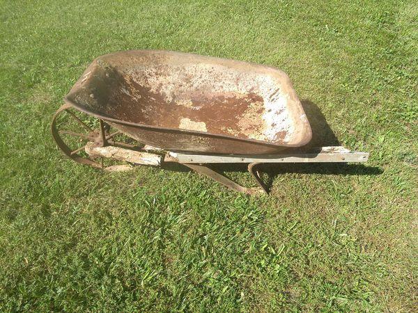 Rustic wheel barrow with steel wheel