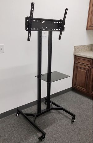 "New in box 28"" depth x 26"" wide x 65"" tall 32 to 65 inch tv television heavy duty stand with locking wheels and shelf soporte de tv for Sale in Covina, CA"