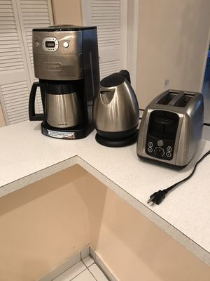 Kitchen appliances: stainless steel grind and brew coffee maker, tea kettle, toaster in excellent condition. Plus meat grinder free with purchase. for Sale in SUNNY ISL BCH, FL