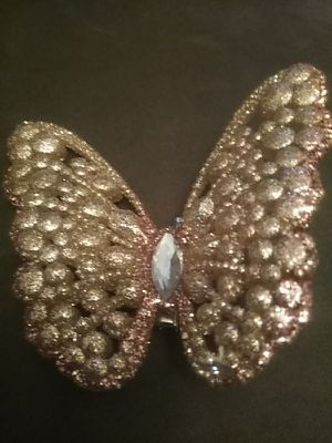 Brand new beautiful rose gold colored clip butterfly. Great for clipping on a basket, artificial flowers in a vase etc. Gorgeous. for Sale in Oviedo, FL
