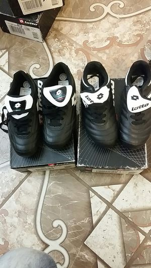 Lotto black youth cleats for Sale in Wichita, KS