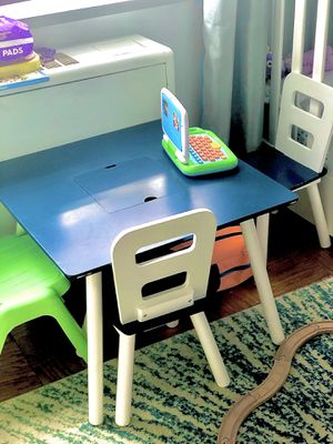 Kid Kraft table with 2 chairs. Inside space for storage for Sale in Brooklyn, NY