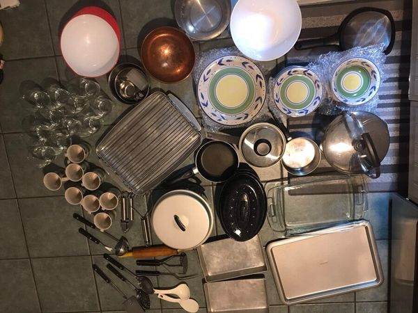 Assorted kitchen and cooking items - bowls, plates, cups, glasses, baking sheets, cooking utensils