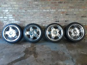 """20"""" Chrome Universal Rims and 90% Tires for Sale in Chicago, IL"""