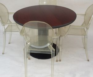 Four Mid Century Modern Styled After Philippe Stark Ghost Chairs and Round Table for Sale in Irvine,  CA