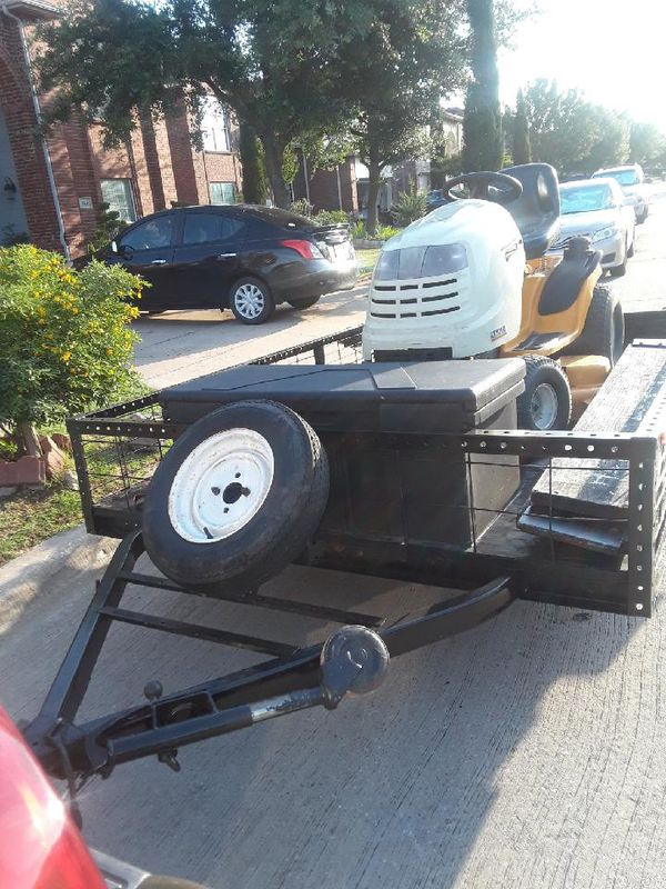 Trailer and mower.