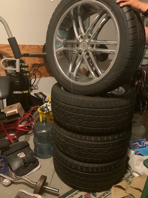"Four 22"" chrome rims and Cooper brand tires"