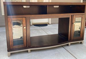 TV Stand, Entertainment Center, Dark wood with silver base for Sale in Roseville, CA