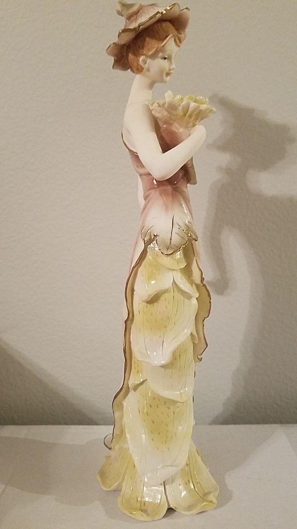 Flower lady figurine