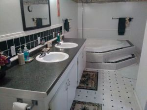 Basement with Huge Hot Tub for Sale in Rosedale, MD