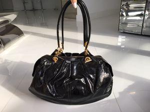 Alexander McQueen black patent leather purse for Sale in Miami, FL