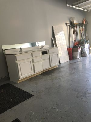 Free 5ft x 60 inch mirror and vanity top faucets and countertop.... for Sale in Mount Rainier, MD