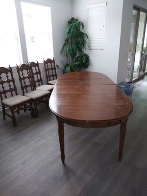Kitchen table with 3 leaves and 10 chairs 44w x 66 l without leaves (3 leaves are additional 18 in each) for Sale in Tustin, CA