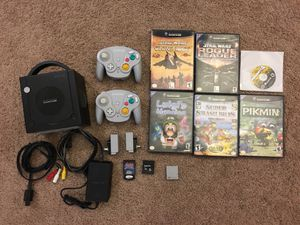 Nintendo GameCube w/2 wavebird controllers, 3 memory cards, & 6 Epic Games (Super Smash Bros, Mario Party 4, Luigi's Mansion, Pikmin, Star Wars Rogue for Sale in Framingham, MA