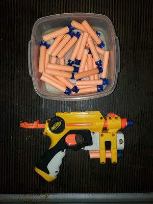 Like new, Nerf Gun with laser and more than 30 extra nerf pieces to shoot. for Sale in Manassas, VA