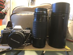 Olympus OM 10 35 mm film camera + 50 mm Zuiko lens + Manual adapter - Very good condition for Sale in Windsor, CO