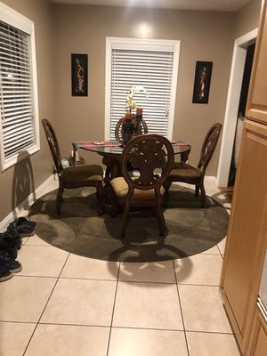 Round glass dining table and 4 chairs for Sale in Los Angeles, CA