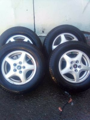 MICHLEAN 215/70/15 PONTIAC RIMS AND BRAND NEW TIRES for Sale in Brier, WA