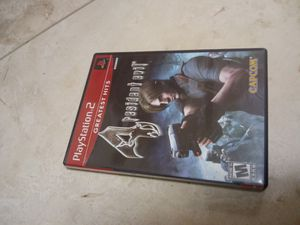 PS2 Resident evil 4 - game - piss 2 - system - TV - controller - accessories - disc/memory card / analog control / 127 KB / Capcom Dolby pro logic II for Sale in Naples, FL