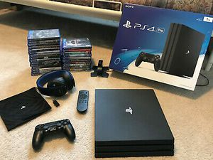 Sony PS4 pro 1TB Black console with 26 Games and sony Remote & Gold headphones for Sale in Chevy Chase, MD