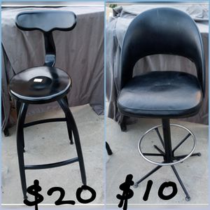 TWO BLACK TALL BAR CHAIRS THE FIRST ONE IS ALL METAL $20 AND THE SECOND ONE SWIVELS $10 for Sale in Bakersfield, CA