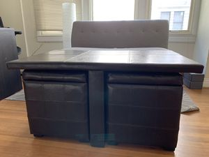 Black leather coffee table with storage slots and two black leather ottomans for Sale in San Francisco, CA