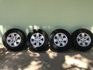 4stock gmc rims and tires 6 lug plus spare and lug nuts for Sale in Jacksonville, FL